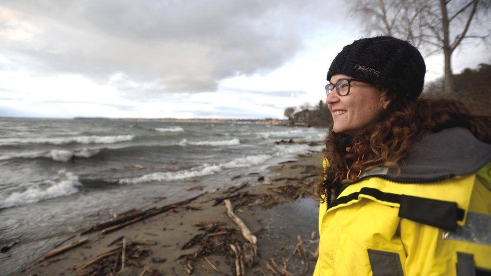 Cora Ball founder Rachael Miller on a beach