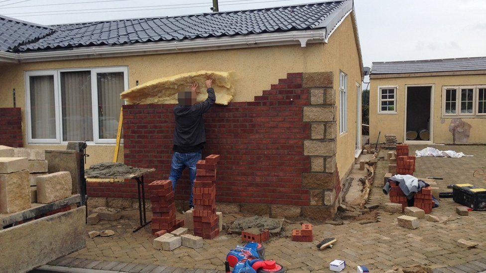 Man working on a wall