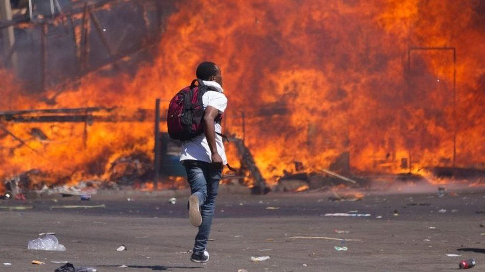 An opposition supporter runs during a protest in Harare, Zimbabwe. Photo: 26 August 2016
