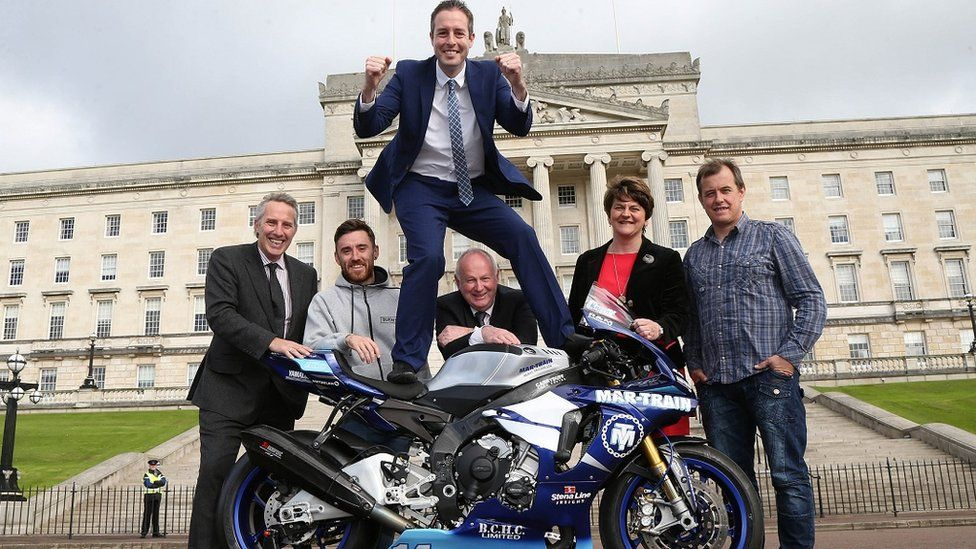 Sports Minister Paul Givan pictured with road racers Lee Johnston and John McGuinness, NW200 Event Director Mervyn Whyte, First Minister Arlene Foster and Ian Paisley MP at Stormont