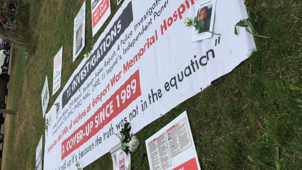 Family tributes and protest banners outside Portsmouth Cathedral