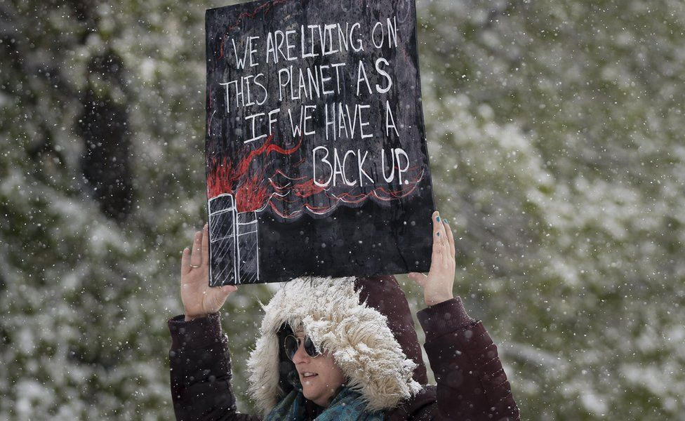 Leah Stein of Parker, Colorado holds a sign while protesting at the People's Climate March on Denver on April 29, 2017 in Denver, Colorado