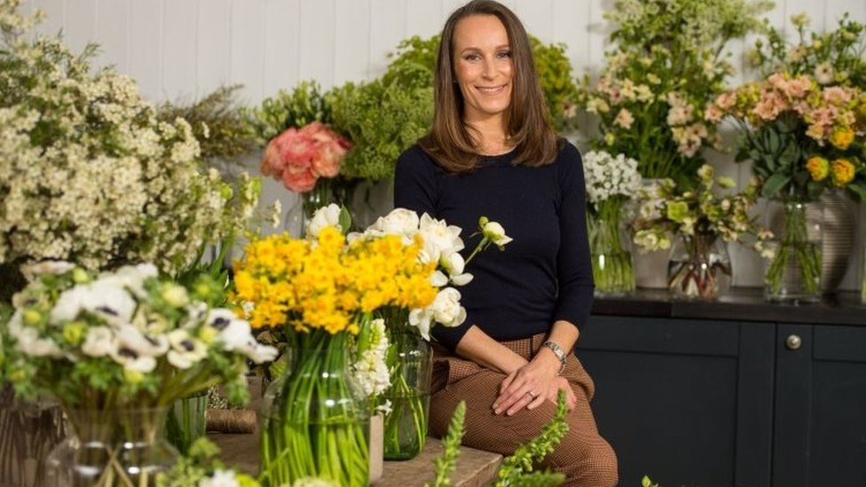 Florist Philippa Craddock surrounded by flowers