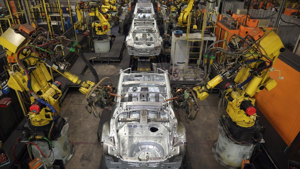 Robotic arms assemble and weld the body shell of a Nissan car on the production line at Nissan's Sunderland