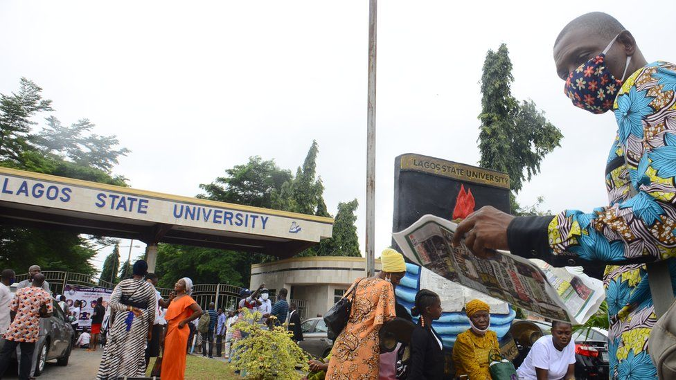 Students outside the gate of University of Lagos