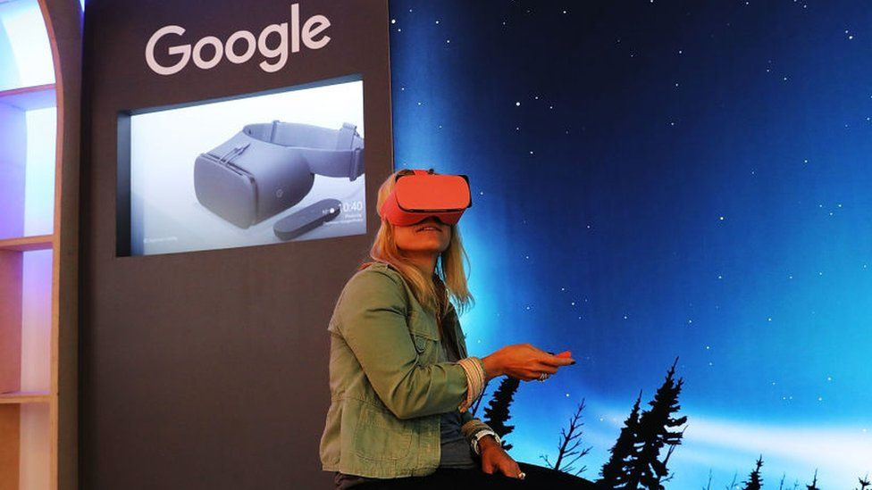 A woman tests out the Daydream VR headset