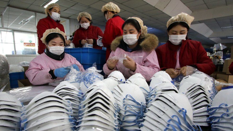 Workers making protective masks