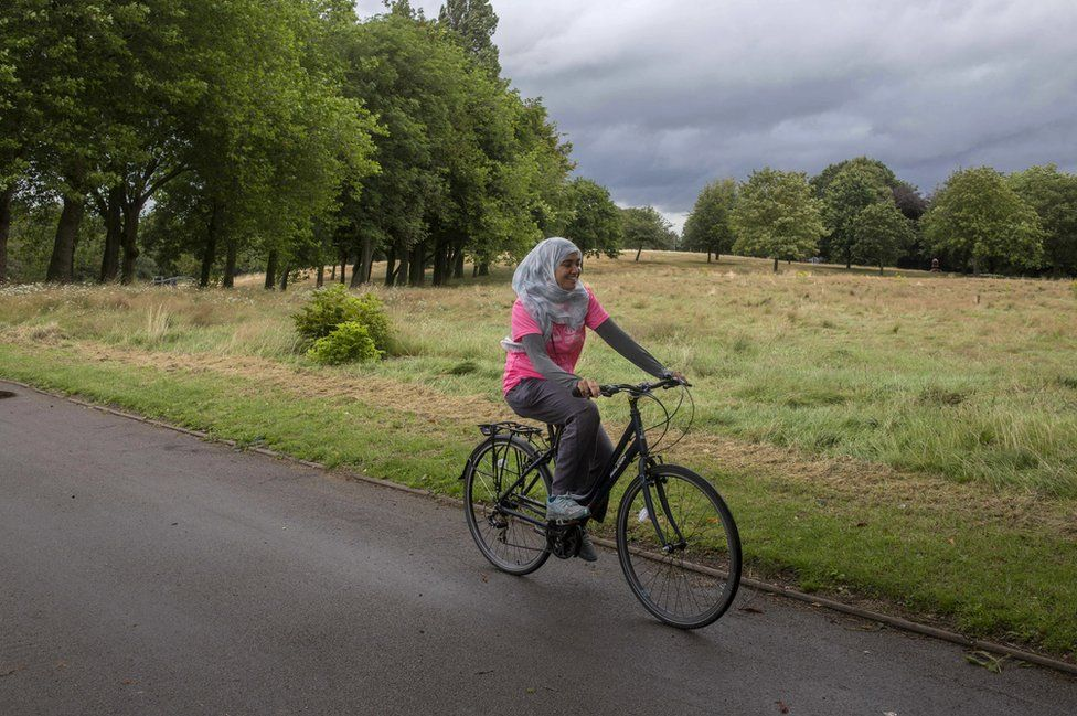 Haseena Aktar riding a bicycle