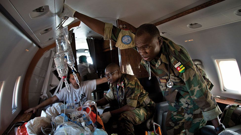 Peacekeepers attending to a wounded person in Mali