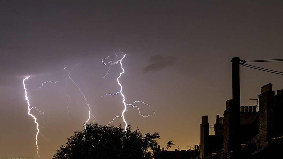 Lightning strikes coming down on the other side of Ocean Terminal in Leith