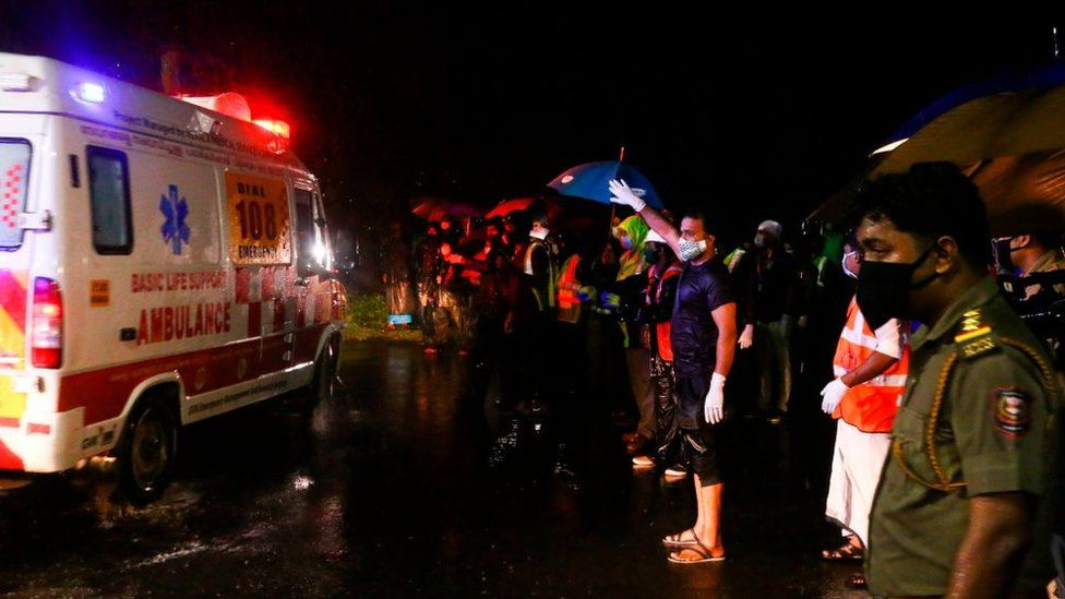 An ambulance carrying injured passengers leaves for a hospital.