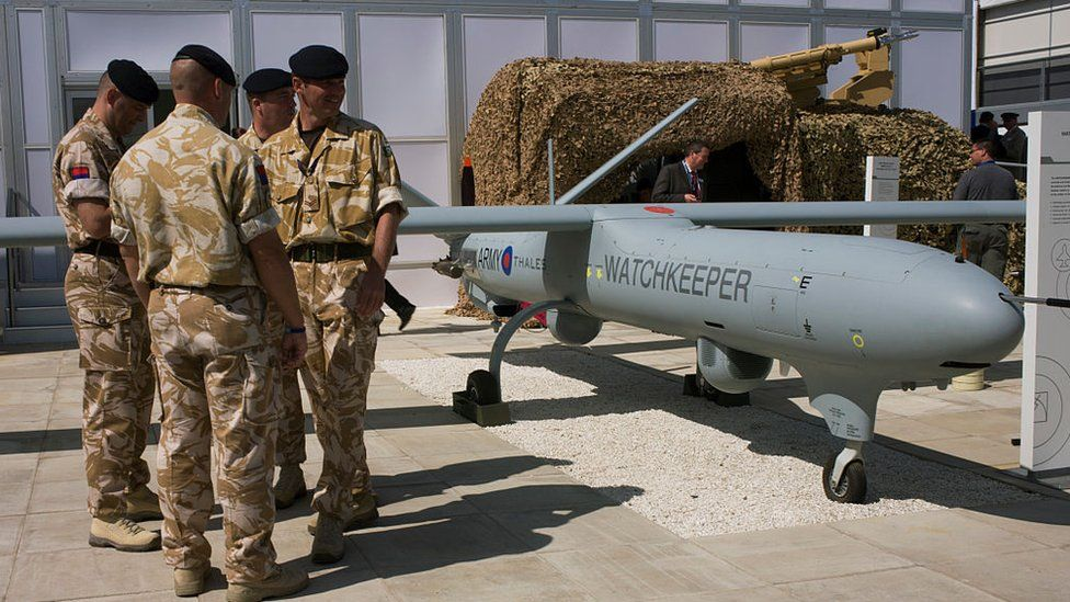 Soldiers stood by a Watchkeeper drone