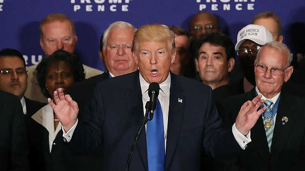 Donald Trump speaks at his hotel in Washington, DC