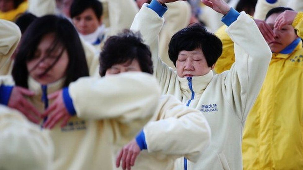 Falun Gong Practitioners meditate on the 14th anniversary of the beginning of the persecution of Falun Gong in China on 21 July 2013 in Sydney, Australia