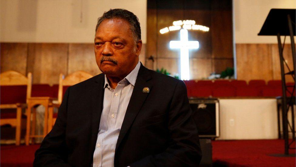 Rev Jesse Jackson sitting in a church