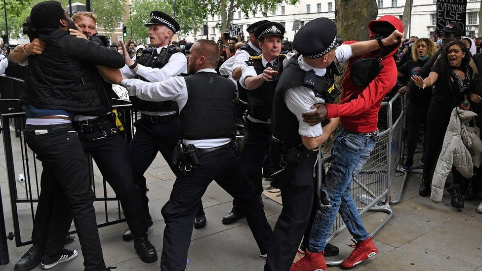 Police clash with protesters outside Downing Street