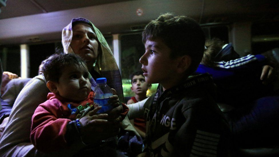 Syrian displaced families, who fled violence after the Turkish offensive against Syria, sit in a bus after arrival at a refugee camp in Bardarash on the outskirts of Dohuk, Iraq October 17,