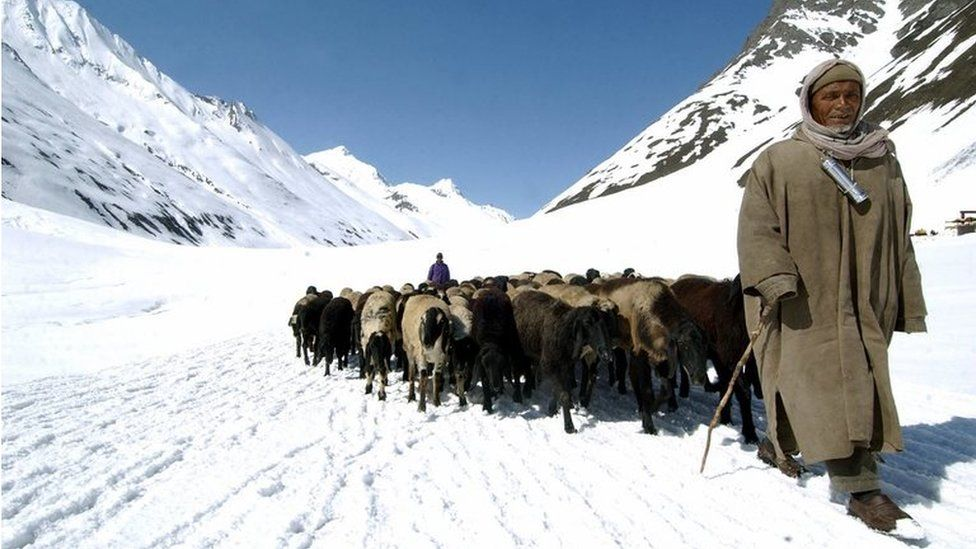 Indian Kashmiri herdsmen are seen at Zojila, in Kargil district north-east of Srinagar
