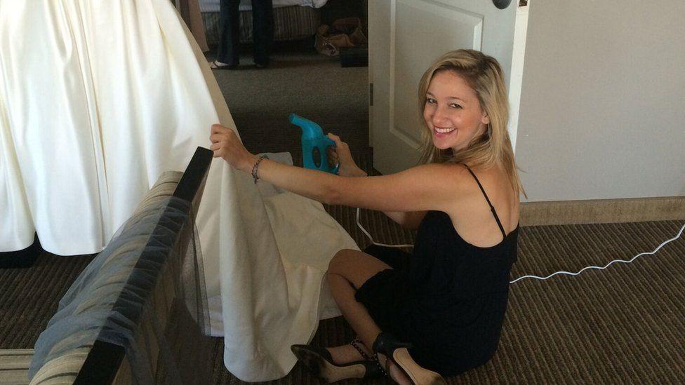 Jen Glantz steaming a wedding dress