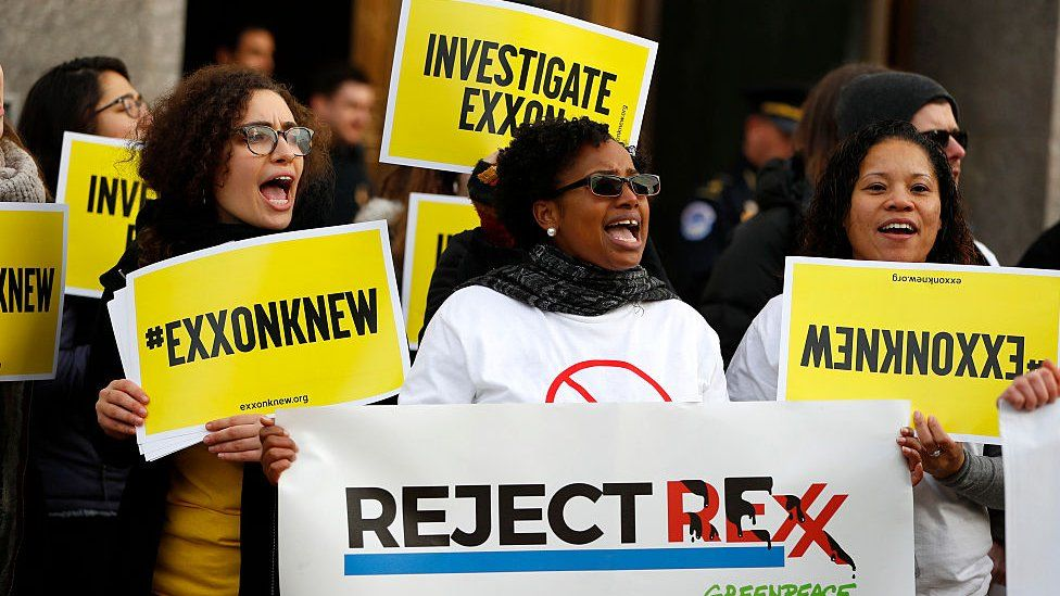 Protesters with #exxonknew signs