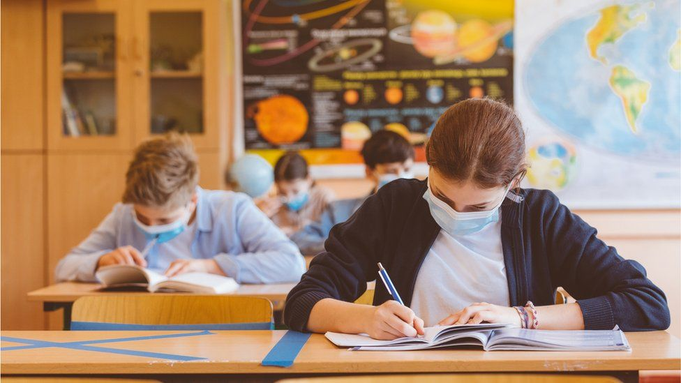 High school students at school, wearing N95 Face masks. - stock photo