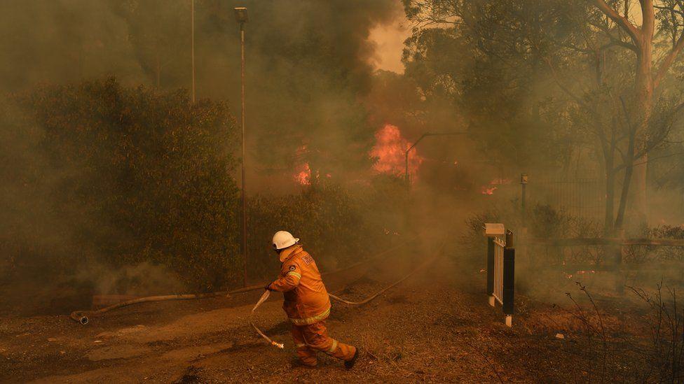 A firefighter tackles a blaze
