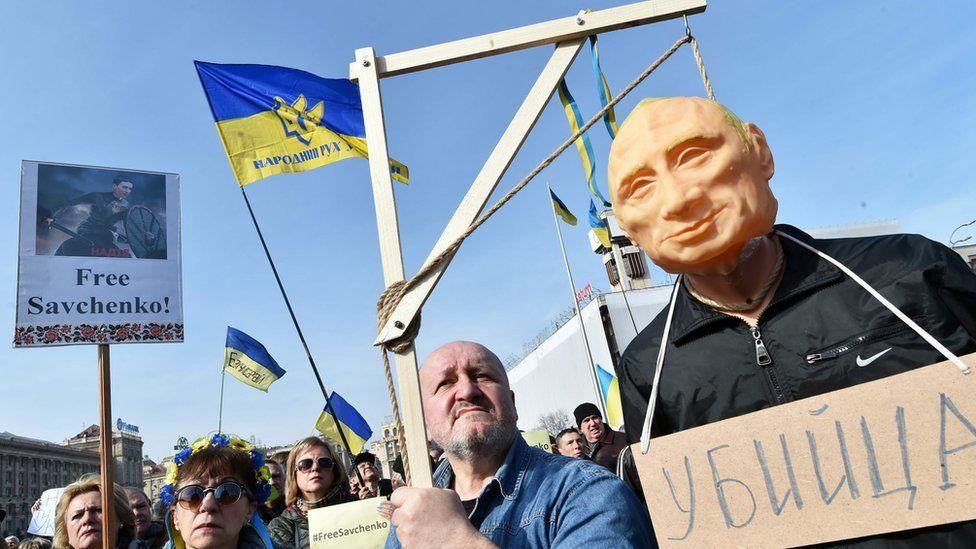 Protesters with an effigy of Vladimir Putin in Kiev, Ukraine