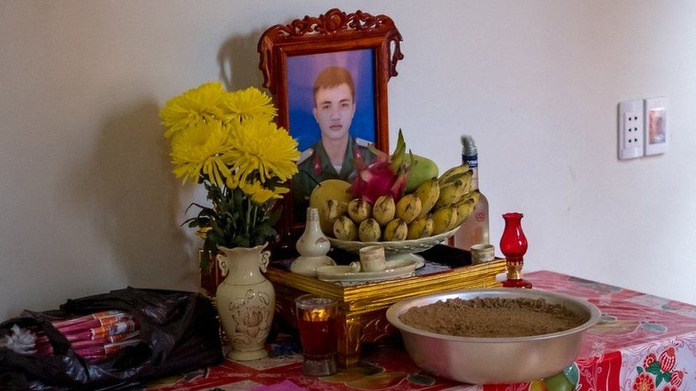 A shrine with a photo of Nguyen Dinh Tu