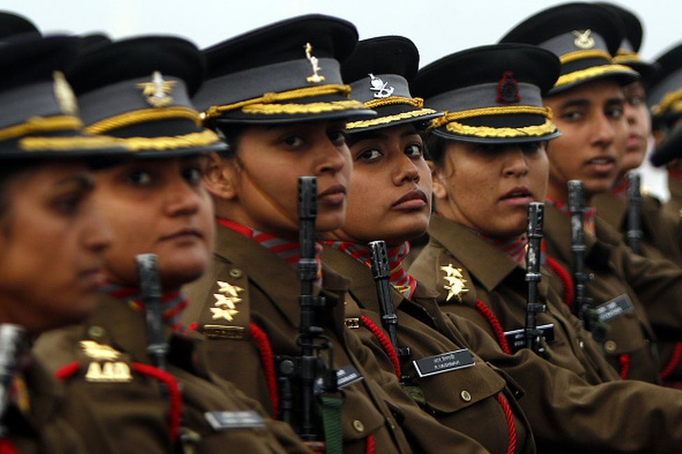 Women officer contingent of the Indian Army march during the Army Day parade at Delhi Cantt on January 15, 2015 in New Delhi.
