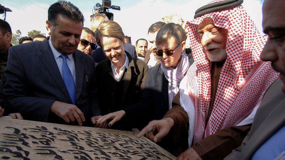The head of Iraq's Sunni Endowment, Abdul Latif al-Humayim, touches the cornerstone for the new Great Mosque of al-Nuri in Mosul (16 December 2018)