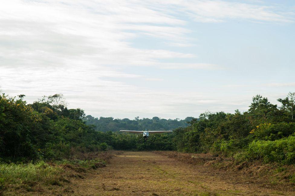 A small aircraft landing at Aldeia Baú, Para State, Brazil