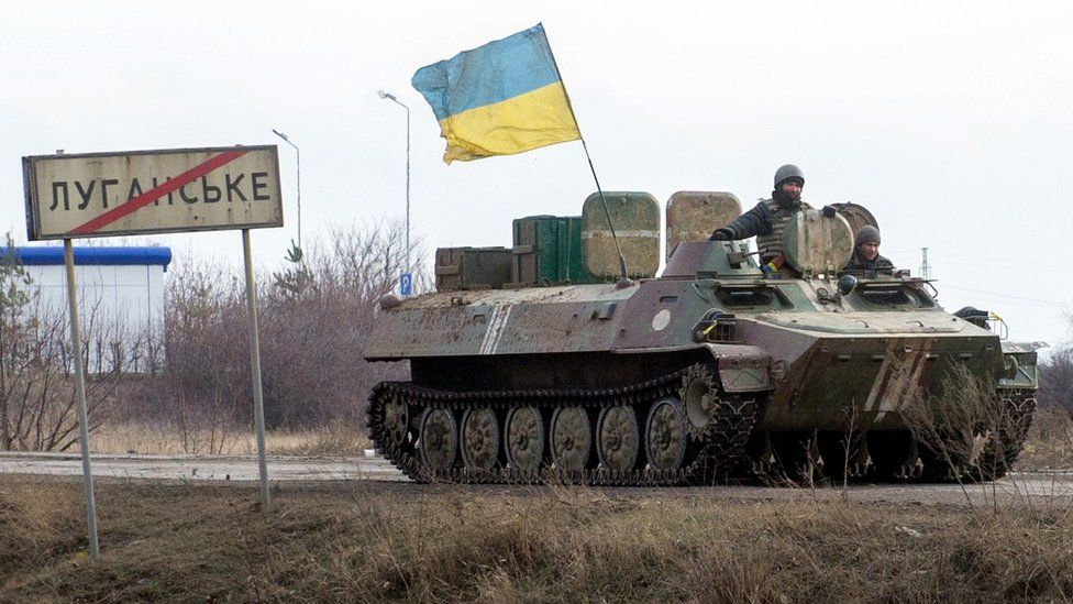 A tank displaying a Ukrainian flag in the Donetsk region