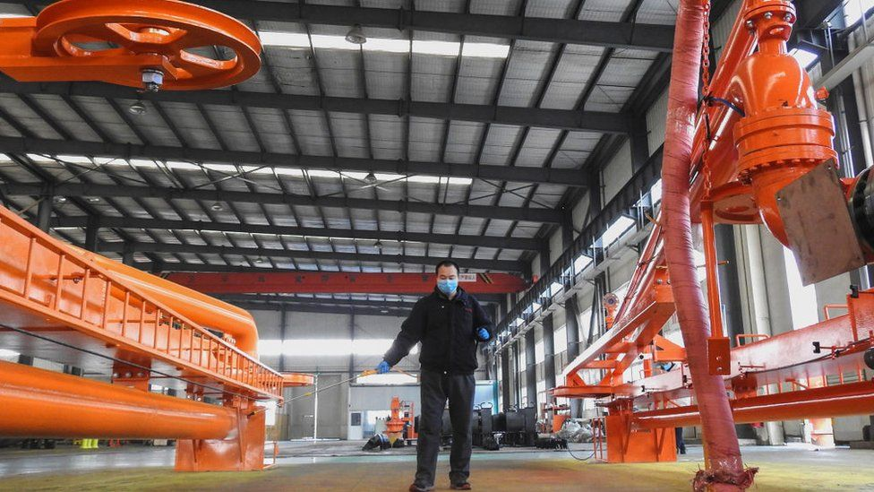 A worker disinfecting machines before workers return to work from holidays at a factory in Lianyungang in China's eastern Jiangsu province.