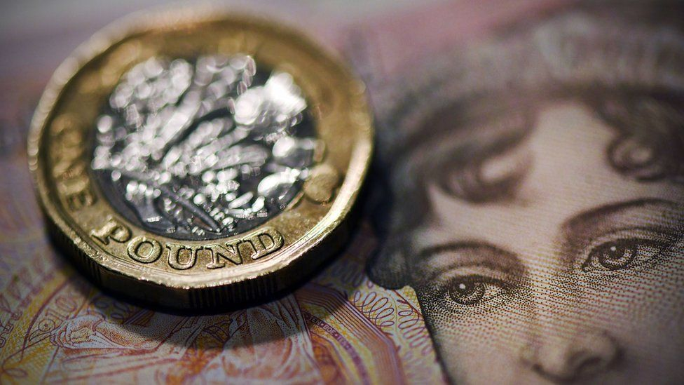 Ten pound note and one pound coin
