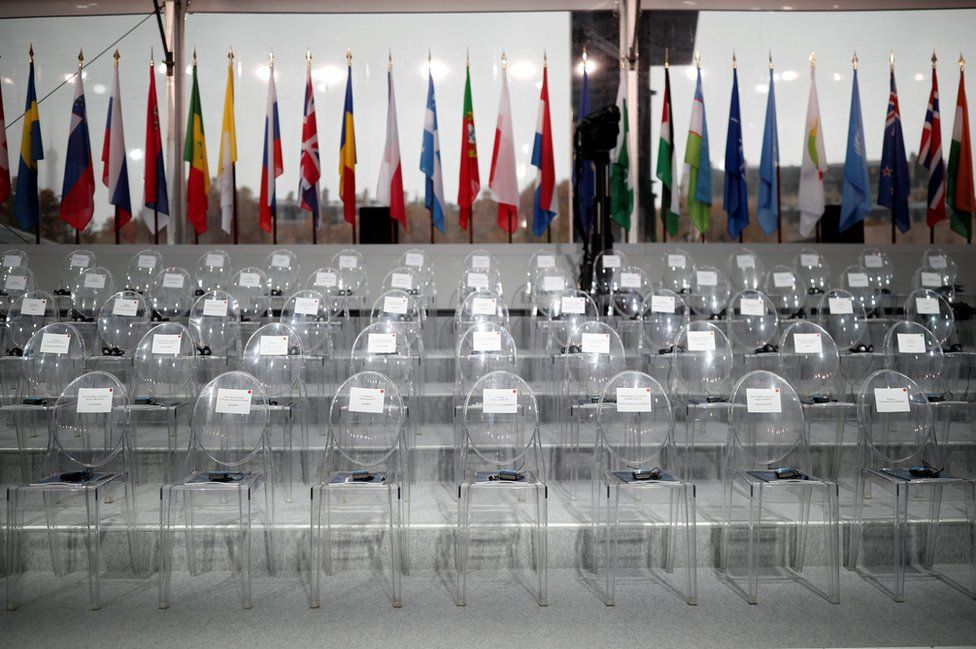 The empty chairs with the names of guests are seen before a commemoration ceremony for Armistice Day