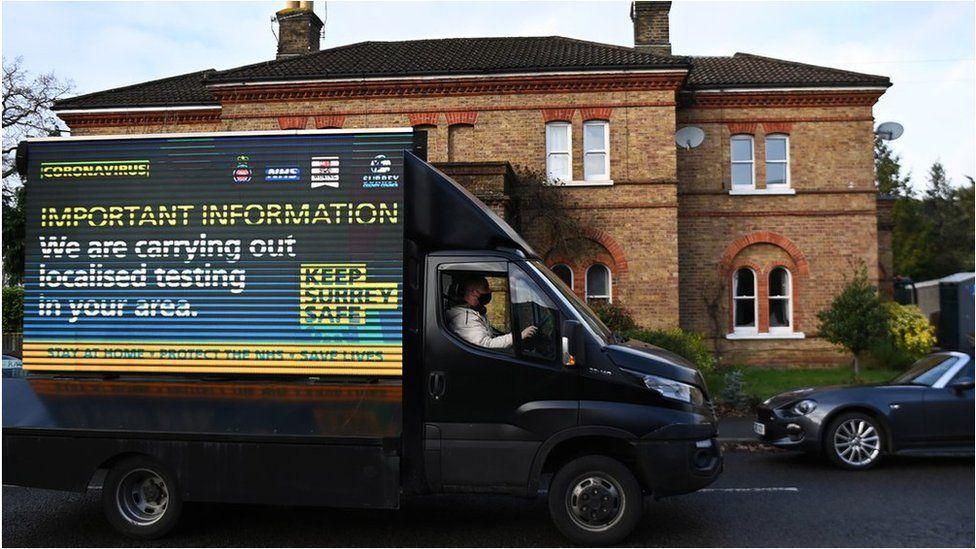 Van carrying testing message in Surrey