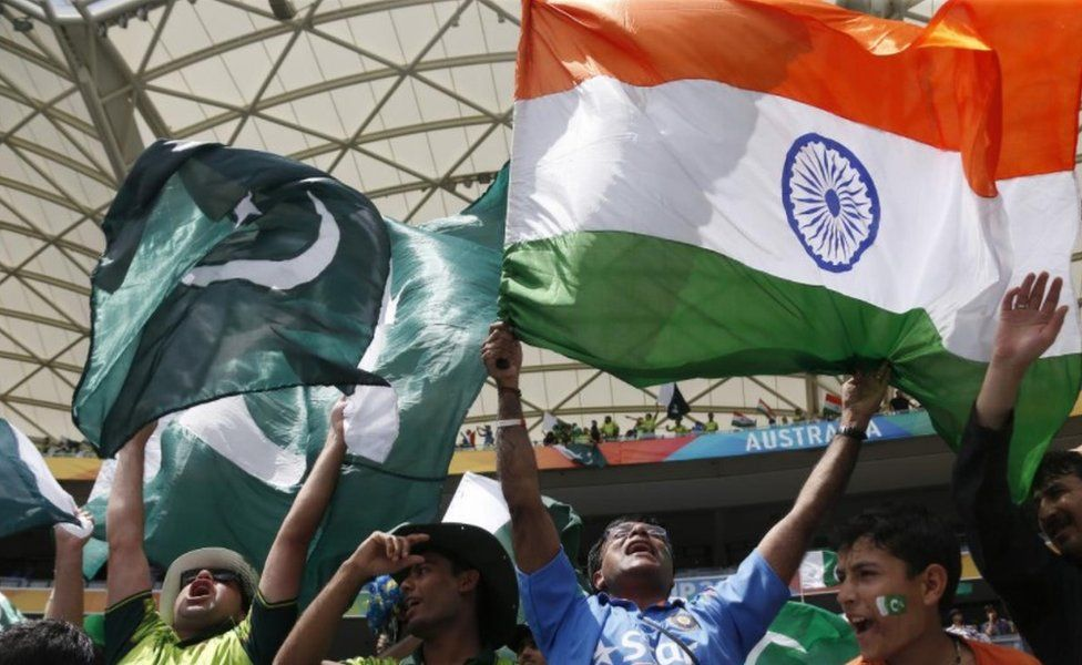 Fans of Pakistan's cricket team (L) and India's team (R) cheer in the stands before a math between the two sides at the Cricket World Cup in Adelaide, February 15, 2015.