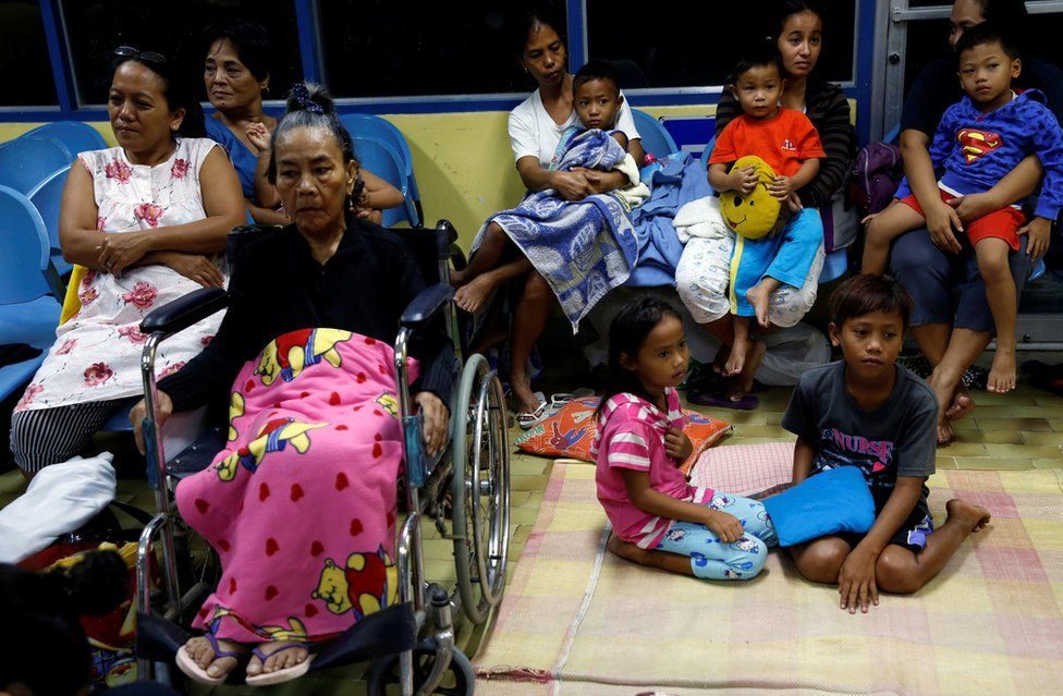 Residents who evacuated their homes due to Typhoon Haima take shelter at an evacuation centre in San Fernando, la Union in the northern Philippines on 19 October, 2016