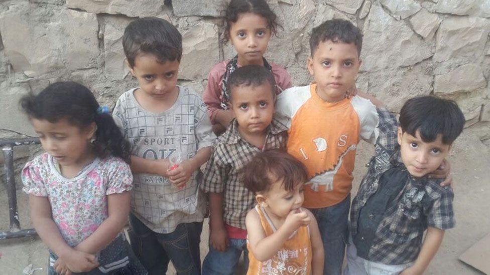 L-to-R: Iman, Ibrahim, Mona, Yaaqoub, Zakariya; (C) Ishaaq, (C, front) Ismail