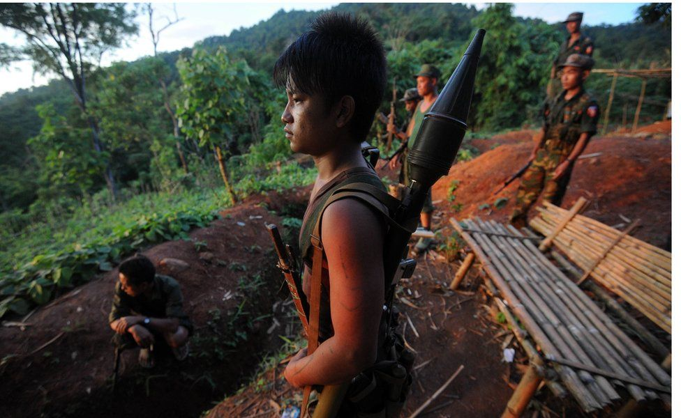 File picture taken in September 2012 showing soldiers from the All Burma Students Democratic Front - Northern Burma (ABSDF-NB), an ally of the Kachin Independence Army (KIA), at an outpost on the Laja Yang frontline