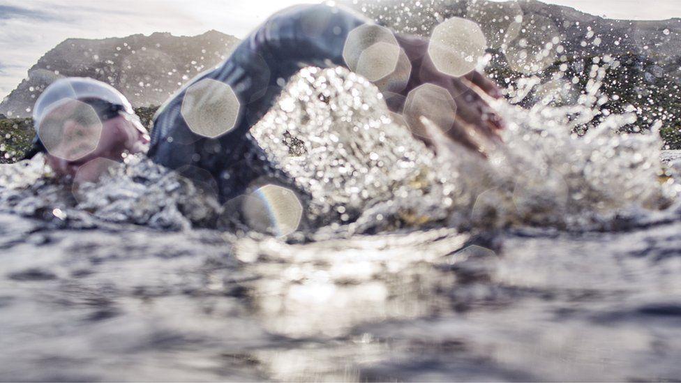 Man doing open water swim