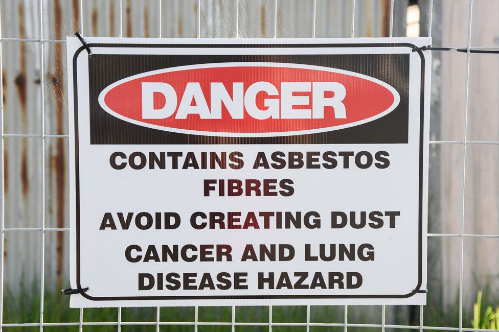 A sign warning of the dangers of asbestos