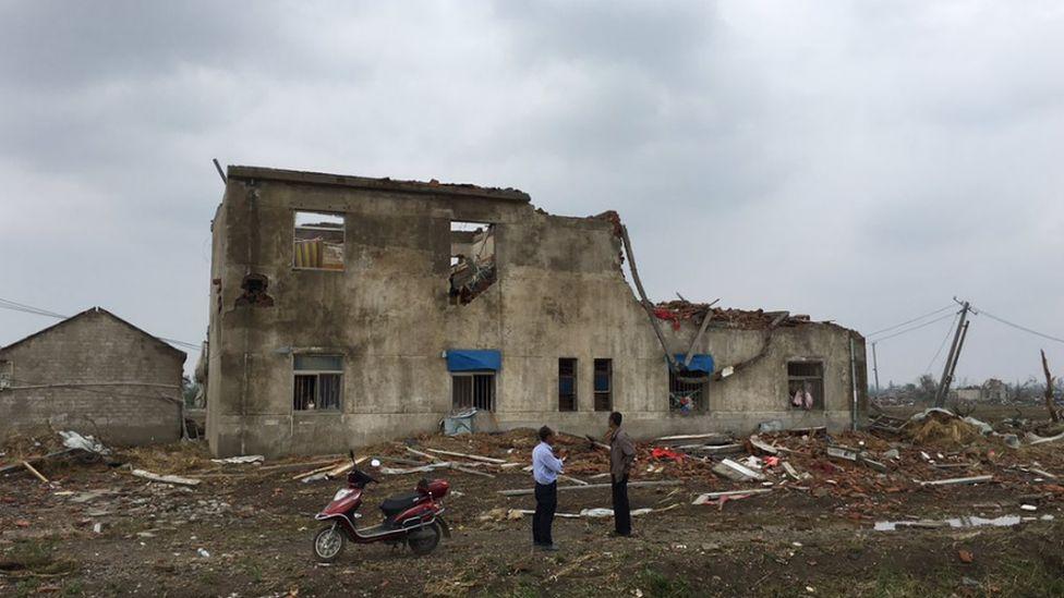 A damaged home in Xintu village