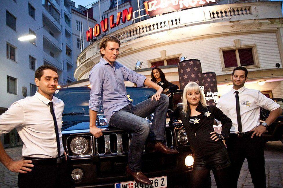 Sebastian Kurz (sitting, centre) in Black is Cool campaign