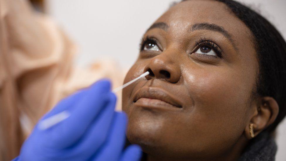 Woman takes a Covid PCR test