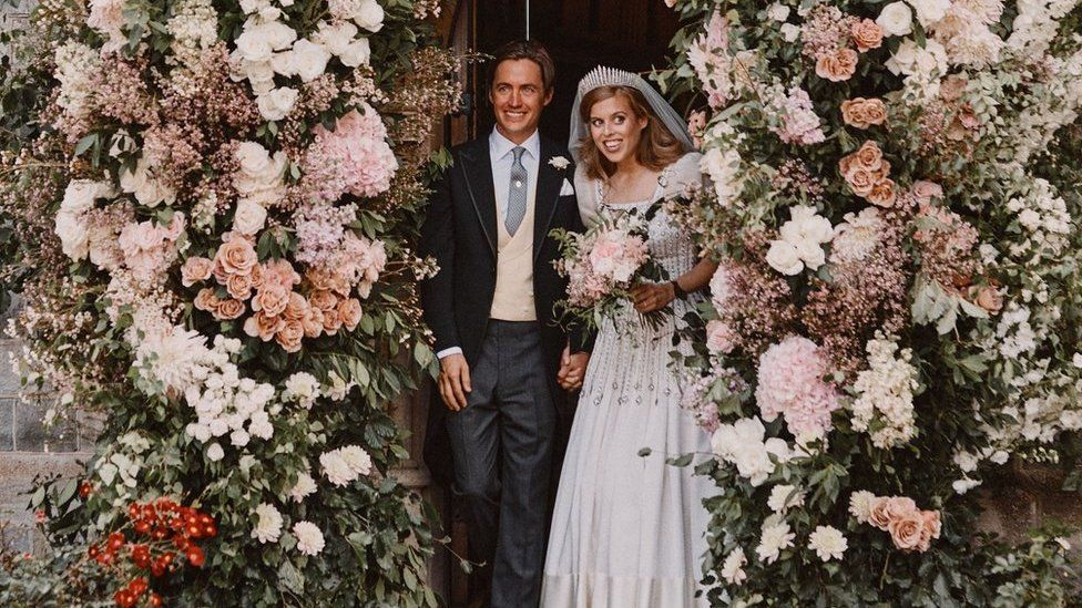 Princess Beatrice and Edoardo Mapelli Mozzi leaving through the flower-covered archway of the Royal Chapel of All Saints at Royal Lodge, Windsor after their wedding