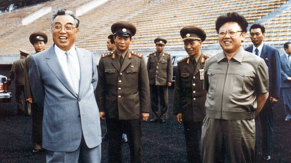 Photo taken in 1992 shows Kim Jong-Il (right) and then-leader, Kim Il-Sung (left), inspecting a football ground in Pyongyang
