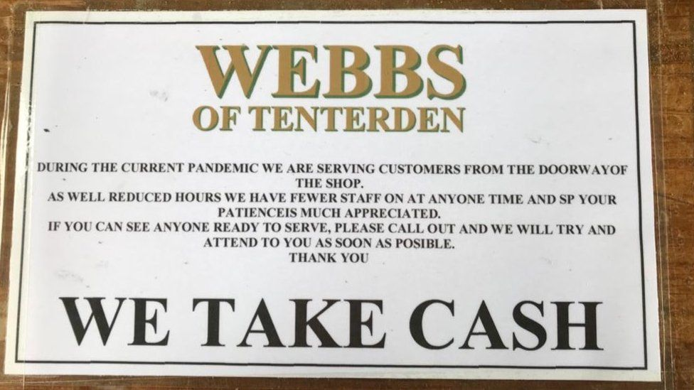 Sign at Webb's saying they take cash
