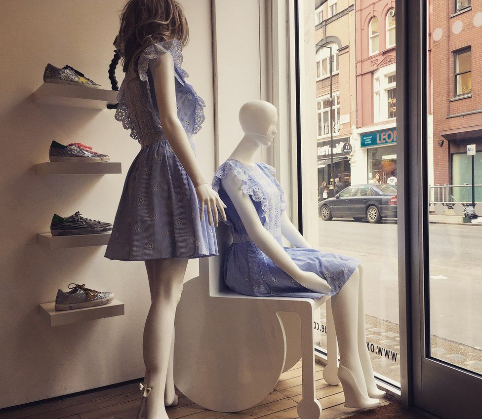 mannequal in shop front window