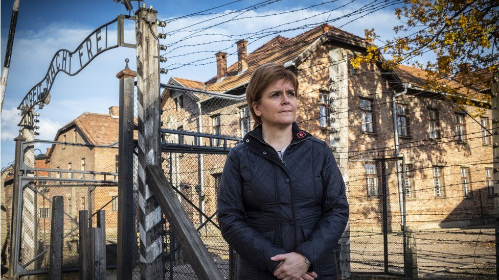 First Minister outside the camp in Auschwitz